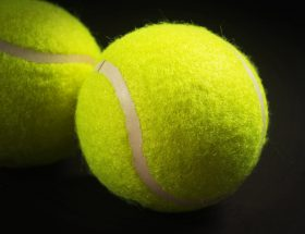 Tennis balls with black background